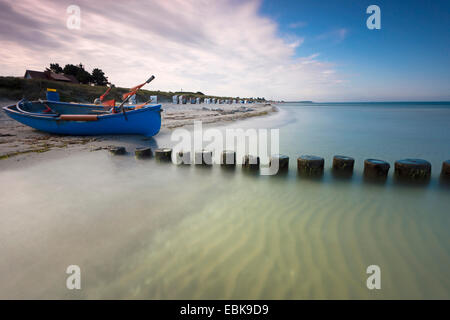 fishing boat and spur dike at Baltic Sea in morning light, longtime exposure, Germany, Mecklenburg-Western Pomerania, - Stock Photo