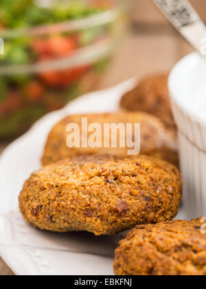 Homemade falafels with yogurt tahini sauce and parsley salad. - Stockfoto