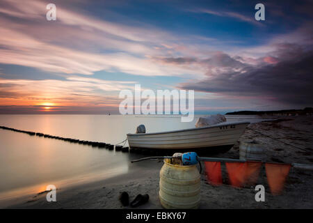 fishing boat and spur dike at Baltic Sea in evening light, longtime exposure, Germany, Mecklenburg-Western Pomerania, - Stock Photo