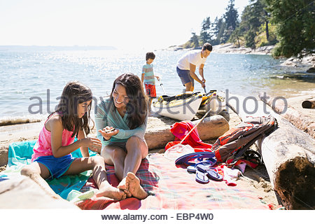 Family playing on sunny beach - Stock Photo