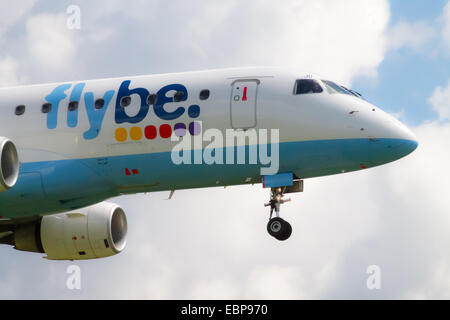 Flybe Embraer 175 landing to Manchester International Airport. - Stock Photo