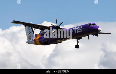 Flybe Bombardier Dash 8 Q400, landing to Manchester International Airport. - Stock Photo
