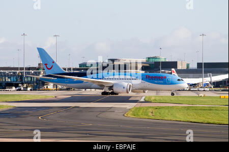 Thomson Airways Boeing 787 Dreamliner (G-TUIE), taxiing on Manchester International Airport runway. - Stock Photo