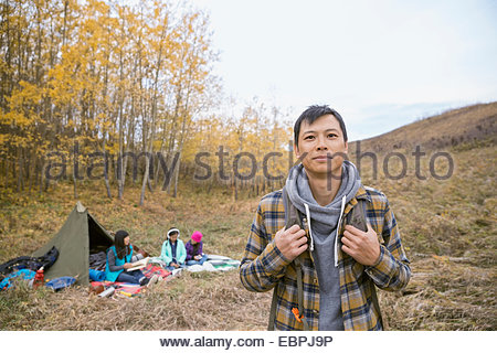 Portrait of man camping with family - Stock Photo