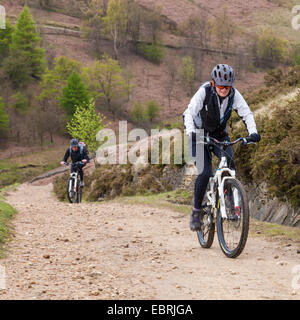 Cyclists cycling up the north side of Jaggers Clough, Derbyshire, Peak District, England, UK - Stock Photo