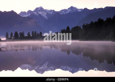 Mt. Tasman and Mt. Cook (Aoraki) mirroring in Lake Matheson, New Zealand, Southern Island, Westland National Park - Stock Photo
