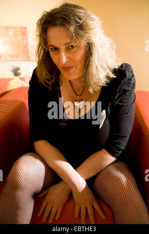 Legs Of A Woman In Black Stockings And Sexy Red High Heel