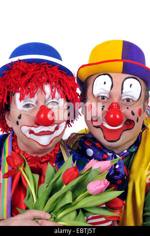 couple dressed up as clowns - Stock Photo