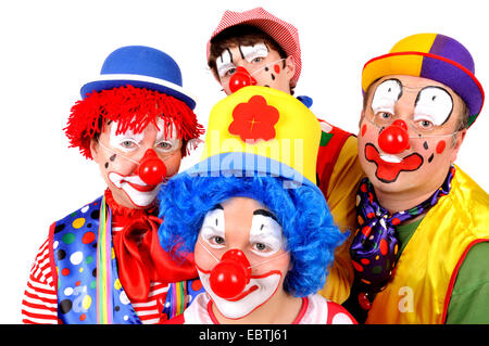 family dressed up as clowns - Stock Photo