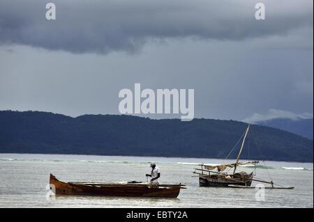 outrigger canoe off the coast, Madagascar, Nosy Be - Stockfoto