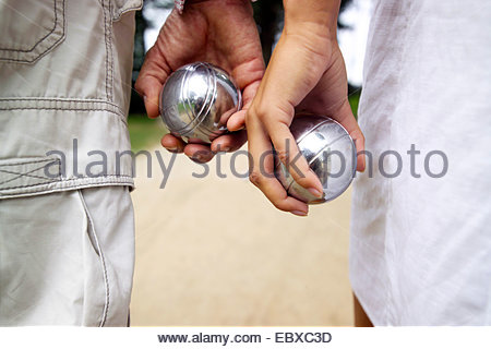 hands with boule balls - Stock Photo