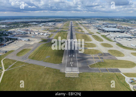 An aerial view looking West down runway 27L at Heathrow Airport, London - Stock Photo