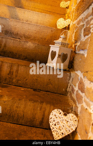Wicker hearts and lanterns on stone steps. - Stock Photo