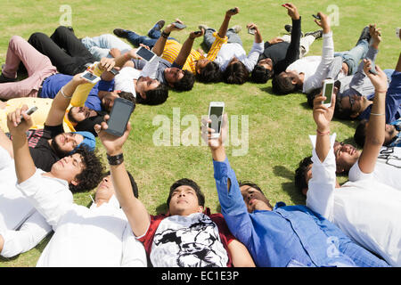 indian friends group Crowds park - Stock Photo