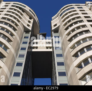 Arch between two office buildings. Bottom view. - Stock Photo