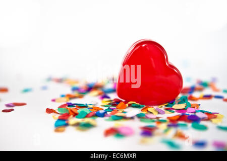 Red heart with colorful confetti on white - Stock Photo
