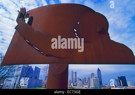 A unique steel sculpture of Dr. Martin Luther King, Jr. stands along Atlantas Freedom Parkway over the city skyline. - Stock Photo