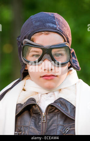 USA, Pennsylvania, Lancaster County, Lancaster, Portrait of boy wearing leather pilot cap and goggles - Stock Photo