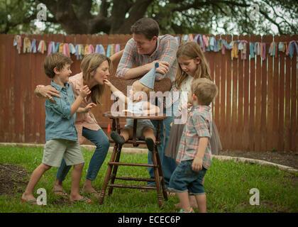 USA, Texas, Williamson county, Family celebrating birthday in back yard - Stock Photo