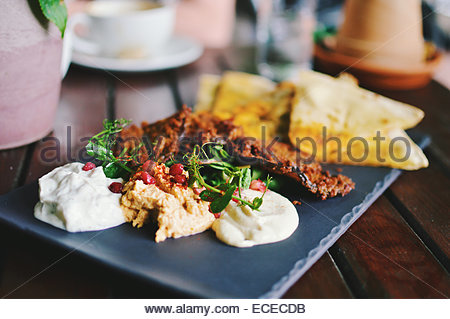 Mediterranean mezze with flat bread, hummus and pomegranate - Stock Photo
