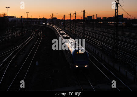 Train about to go under Donnersbergerbrücke bridge in Munich, heading for the Munich central station. - Stock Photo