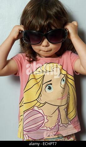 2-year old girl wearing sunglasses - Stock Photo