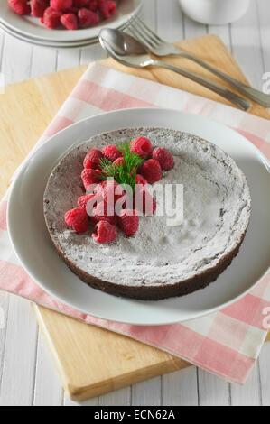 Kladdkaka. Sticky Swedish chocolate cake. Sweden Food - Stock Photo