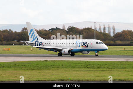 Flybe Embraer 175 taxiing after landing to Manchester International Airport. - Stock Photo