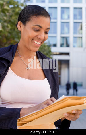 business woman reading letter - Stock Photo