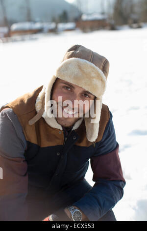 Portrait of man in snow - Stock Photo