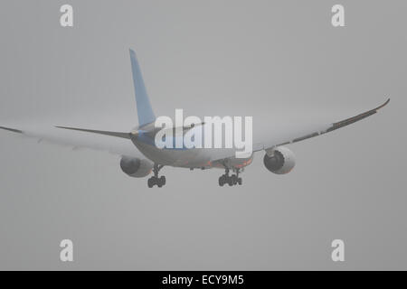 Aircraft landing in bad weather condition at London Gatwick Airport - Stock Photo