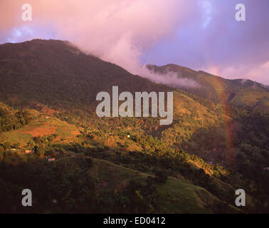 View of the Blue Mountain Range showing rainbow, Jamaica, Greater Antilles, Caribbean - Stock Photo