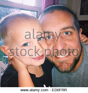 Portrait of father and son - Stock Photo