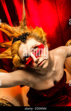 Fantasy makeover photography - Seven Deadly Sins - Wrath : A young woman girl model with spiky punky hair made up - Stockfoto