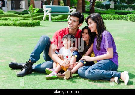 indian Parents with children  park enjoy - Stock Photo