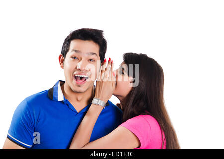 2 indian Beautiful Couple Whisper - Stock Photo