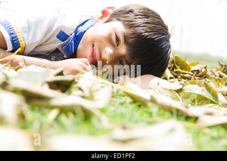 1 indians Child boy park rest - Stock Photo