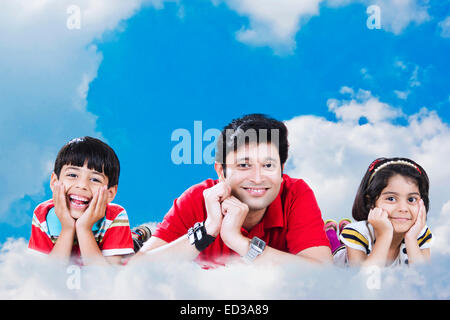 indian Father with children Sky cloud enjoy - Stock Photo