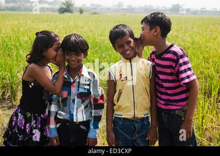 4 indian rural children Field Hearing  Rumour - Stock Photo