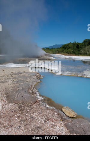 Melanesia, Papua New Guinea, Fergusson Island, Del Del Hot Springs. Volcanic hot springs, natural steaming blue - Stock Photo