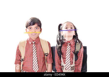 2 indian children schooll studens  Mischief - Stock Photo