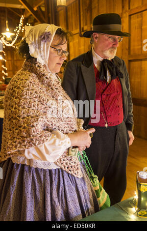Old Bethpage, New York, USA. 26th Dec, 2014. Wife SHERRI GUTHRIE and husband CHART GUTHRIE, dressed in traditional - Stock Photo