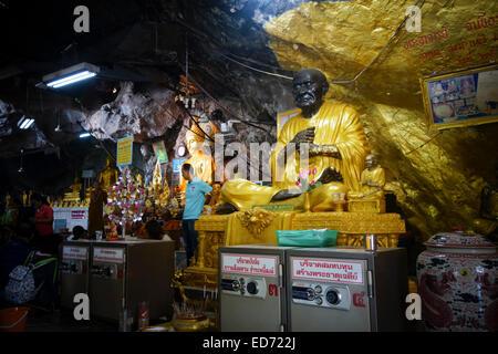 Inside Tiger cave Buddhist temple Wat Tham Suea. Krabi, Thailand, Southeast Asia - Stock Photo