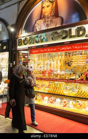 Muslim women by goldsmiths jewelry shop in The Grand Bazaar, Kapalicarsi, great market, Beyazi, Istanbul, Republic - Stock Photo