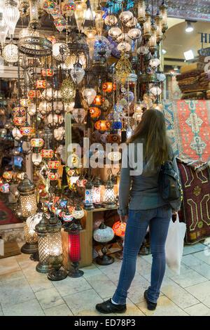 Western tourist shopping inside The Grand Bazaar, Kapalicarsi, great market in Beyazi, Istanbul, Republic of Turkey - Stock Photo