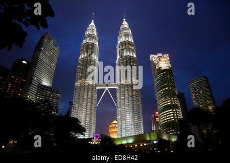 Petronas Towers in Kuala Lumpur at night, Malaysia - Stock Photo