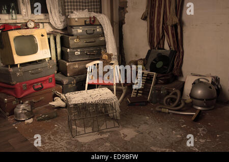 Assorted Junked Old Items in an Old Room with Luggage, Cage, Television and Other Items. - Stockfoto