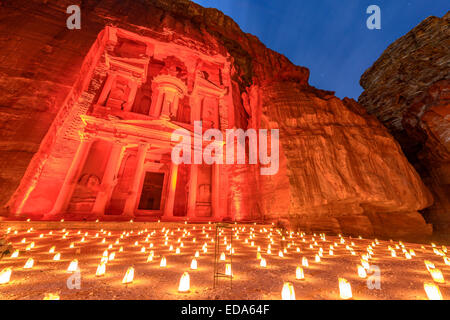 Treasury (Khasneh) in Petra, Jordan at night. Petra by Night in the light of 1,800 candles. - Stock Photo