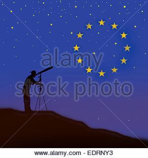 Man looking through telescope watching European Union flag constellation - Stock Photo