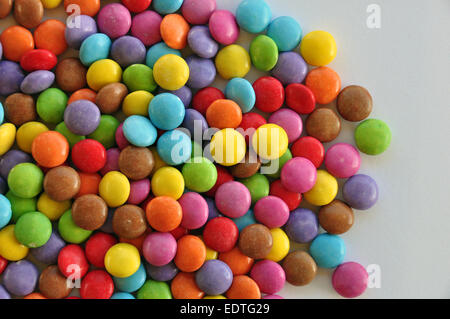 Colorful candy on white background. Chocolate snack. - Stock Photo